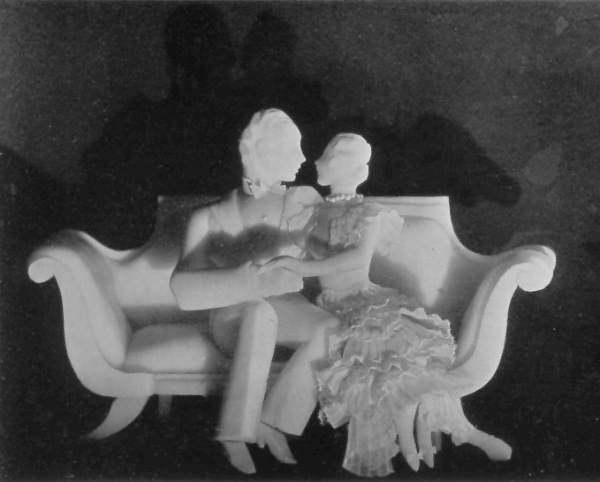Soap sculpture of a man and woman on a divan